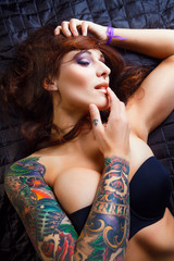 Beautiful girl with stylish make-up and tattooed arms,,,