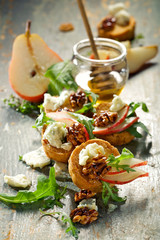 Canapes with blue cheese, pear and caramelized walnuts