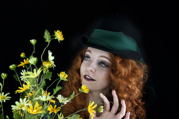Woman wearing top hat with green tulle and flowers