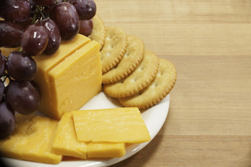 Cheese and Crackers with Grapes on Plate