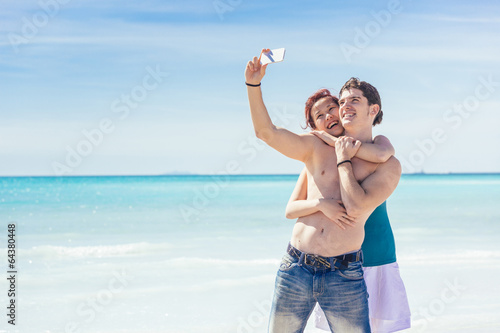 Young Couple Taking Selfie at Beach