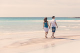 Young Couple Walking on Caribbean Beach
