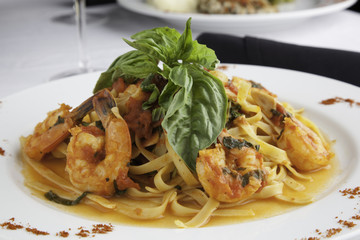 Shrimp and Linguine Fra Diavolo Topped with Fresh Basil 2