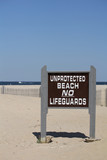 Unprotected Beach Sign No Lifeguards poster