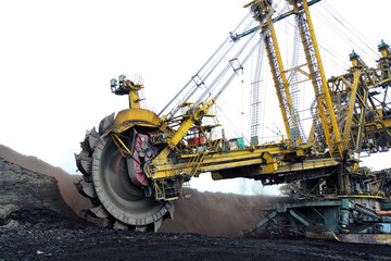 huge yellow  coal excavator in action