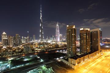 Burj Khalifa and Dubai Downtown at dusk. UAE