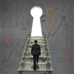 walking on money stairs to key door with business dooles