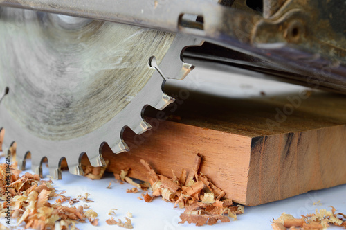 close up of circular saw and saw dust - 64384615