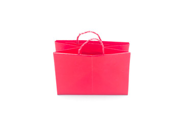 Red paper bag in white background.