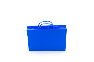 Blue paper bag in white background.
