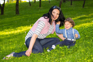 Mother and boy having fun in grass