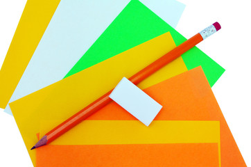 different colors of papers and pencil with eraser