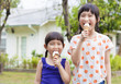 Cute little Girls  Eating Ice Cream