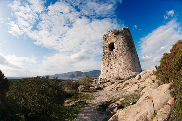 Coastal Tower in the blue sky and rocks