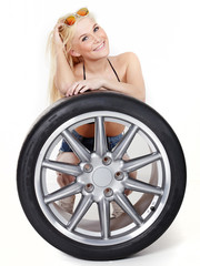 Sexy woman with summer tire