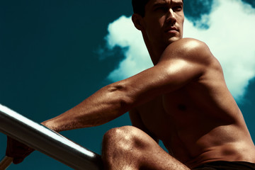 Muscular athletic sportsman in training