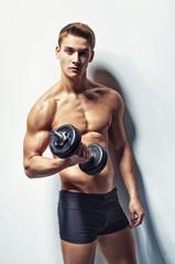 Young bodybuilder man exercising
