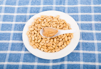 Spoon of Peanut Butter on Bowl of Peanuts