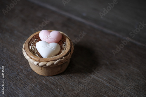Heart shape soaps with word 'Love' on wooden background