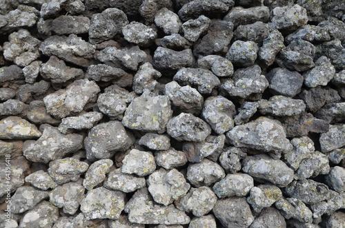 Etna's lava stones wall in a garden