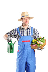 Male florist holding a watering can and flowers