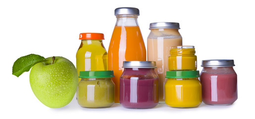 Composition of baby food jars and juice bottles on white