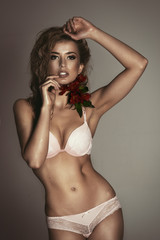 Photo of sexy blonde young girl with flower