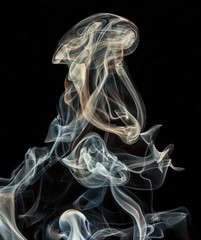 abstract colored smoke isolated on a black background