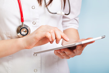young doctor with digital tablet