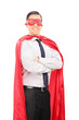 Young man in superhero costume