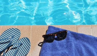 Poolside holiday vacation scenic sunglasses towel shoes