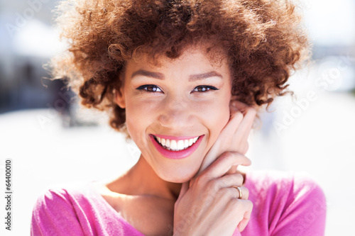 Attractive African American woman outdoors - 64400010