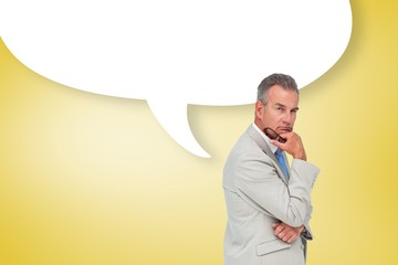 Composite image of thinking businessman with speech bubble