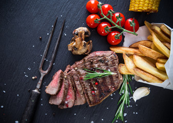 Beef steak on stone background