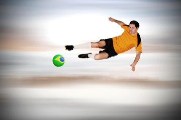 Composite image of football player in orange jumping