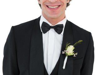 Mid section of groom smiling