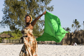 Beautiful african young woman with scarf on the beach