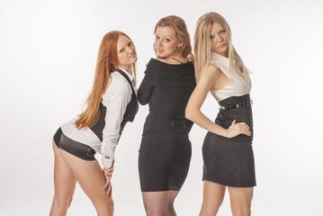 Three slender girls on white background