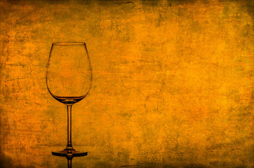 Empty wine glass on nice vintage texture