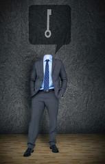 Headless businessman with key in speech bubble