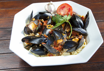 Pasta with Mediterranean mussels in tomato sauce with herbs