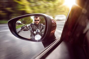 Biker in rear view mirror