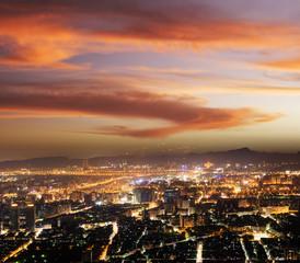 Modern city night under dramatic sky