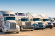 Generic semi Trucks at a parking lot - 64411041