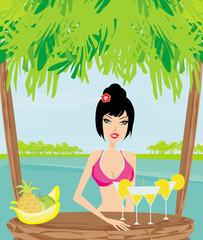 Beautiful young woman at the summer lounge enjoying her fresh co