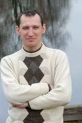 Portrait of smiling senior man on lake