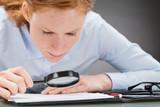 Careful Businesswoman Analyzing Contract