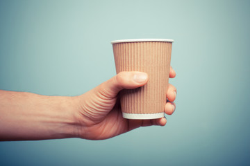Man holding paper cup