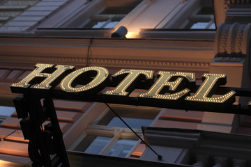 Illuminated yellow hotel sign