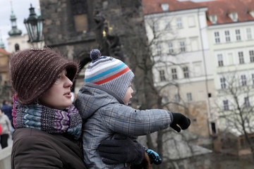Mother and her son at Charles bridge